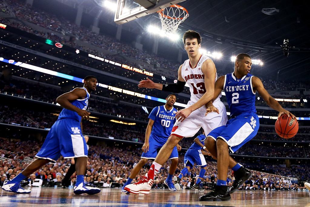 . ARLINGTON, TX - APRIL 05: Aaron Harrison #2 of the Kentucky Wildcats drives to the basket as Duje Dukan #13 of the Wisconsin Badgers defends during the NCAA Men\'s Final Four Semifinal at AT&T Stadium on April 5, 2014 in Arlington, Texas.  (Photo by Tom Pennington/Getty Images)