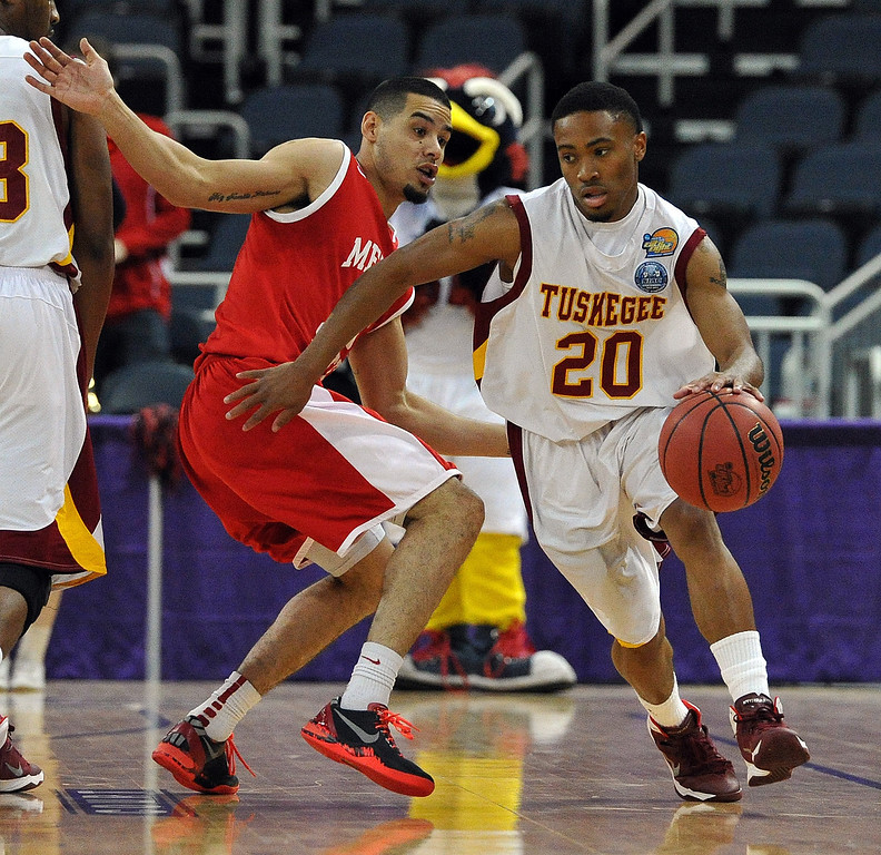 . Tuskegeeís Kevin May(20)  tries to escape the defense of Metro Stateís Raul Delgado during the first half of the NCAA Div. II quarterfinals of the Elite Eight menís basketball tournament at the Ford Center in Evansville, Ind., Wednesday, March 26, 2014.    (AP Photo/The Evansville Courier & Press, Jason Clark)