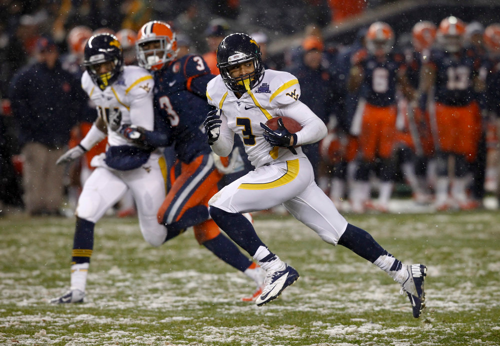 Description of . Stedman Bailey #3 of the West Virginia Mountaineers runs the ball for a touchdown against the Syracuse Orange during the New Era Pinstripe Bowl at Yankee Stadium on December 29, 2012 in the Bronx borough of New York City.  (Photo by Jeff Zelevansky/Getty Images)