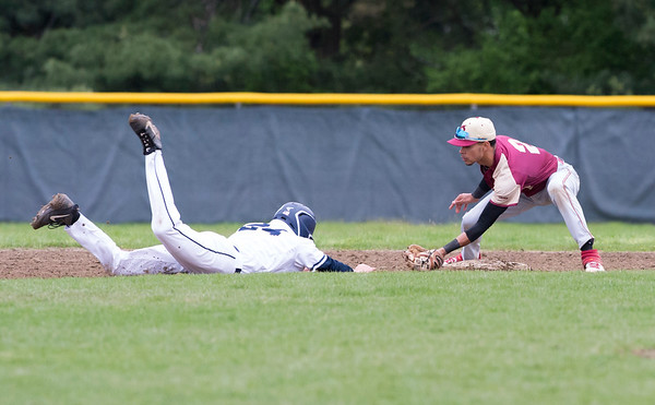 05/14/19 Wesley Bunnell | Staff Newington baseball defeated New Britain 4-3 in a walk off on Tuesday afternoon at Newington High School. Justin Adorno (2) applies the tag on a throw from catcher Michael Gadja (15) to catch the Newington runner off of second base.