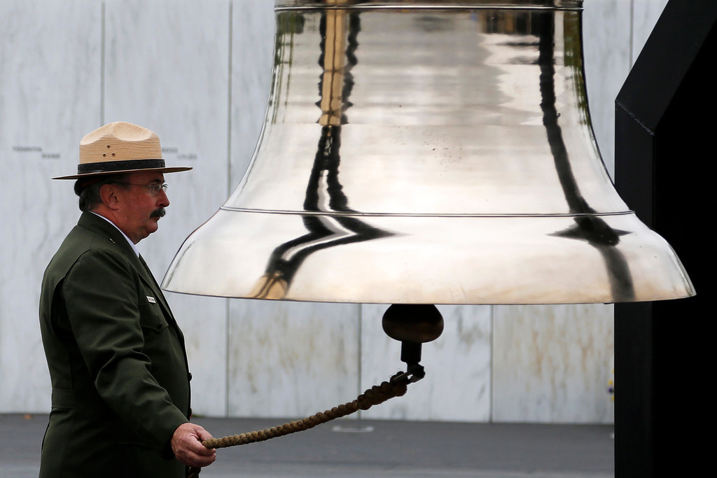 . Keith E. Newlin of the National Park Service rings one of the bells of remembrance during a Service of Remembrance at the Flight 93 National Memorial in Shanksville, Pa., Thursday, Sept. 11,  2014. (AP Photo/Gene J. Puskar)