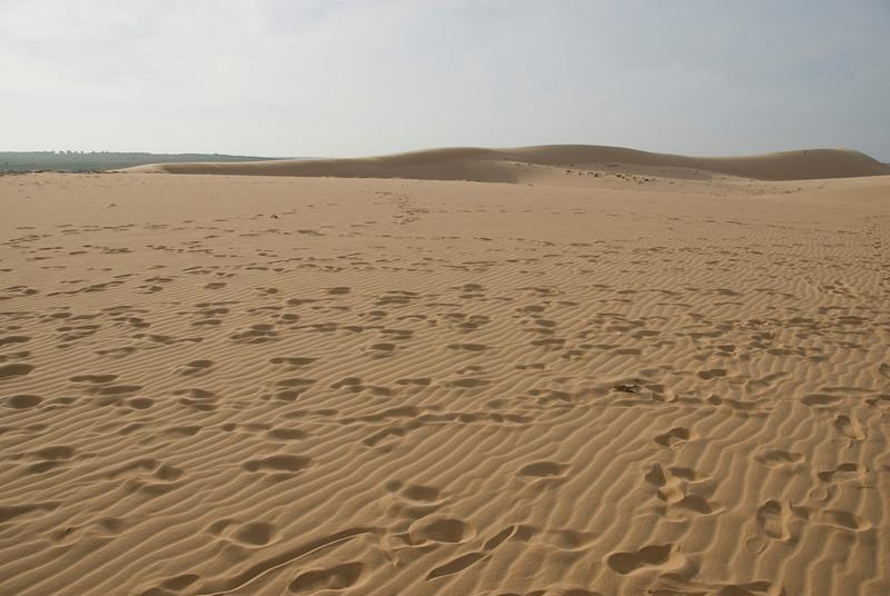 Footsteps on the white sand dunes in Mui Ne, Vietnam