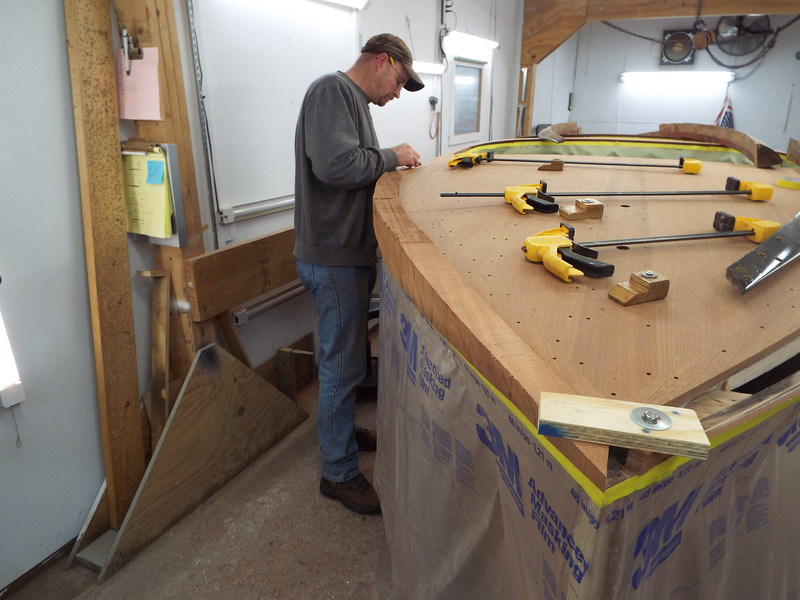 Fitting the front starboard cover board.