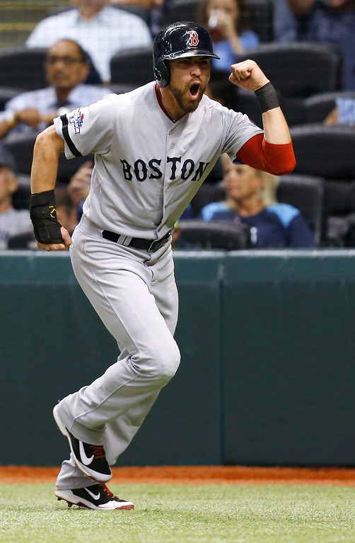 . Boston Red Sox\'s Jacoby Ellsbury celebrates after scoring on a hit by Shane Victorino in the seventh inning in Game 4 of an American League baseball division series, Tuesday, Oct. 8, 2013, in St. Petersburg, Fla.  (AP Photo/Mike Carlson)