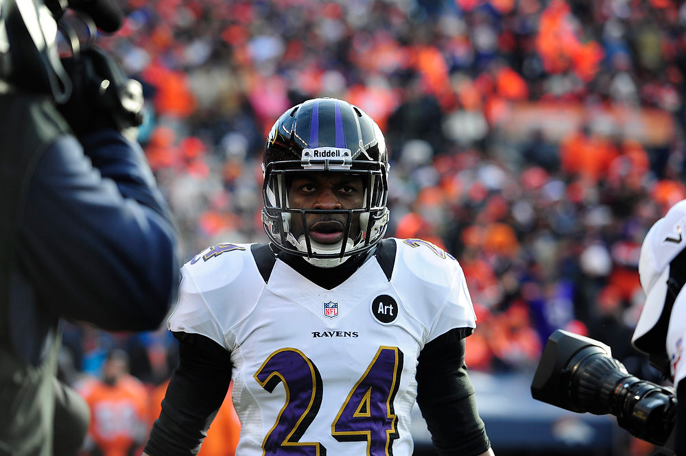Description of . Baltimore Ravens cornerback Corey Graham (24) returns to the sidelines after scoring a touchdown off an interception int eh first quarter. The Denver Broncos vs Baltimore Ravens AFC Divisional playoff game at Sports Authority Field Saturday January 12, 2013. (Photo by AAron  Ontiveroz,/The Denver Post)