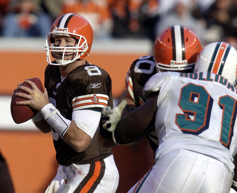 . News-Herald file Browns quarterback Trent Dilfer looks to pass as center Jeff Faine blocks Miami defender Vonnie Holiday Sunday during the third quarter of the Browns win at Cleveland Browns Stadium.
