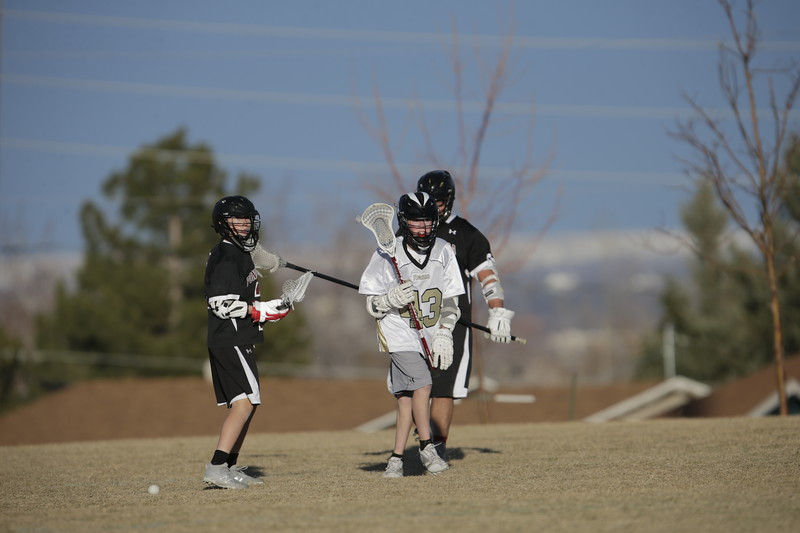 JPM0487-JPM0487-Jonathan first HS lacrosse game March 9th.jpg