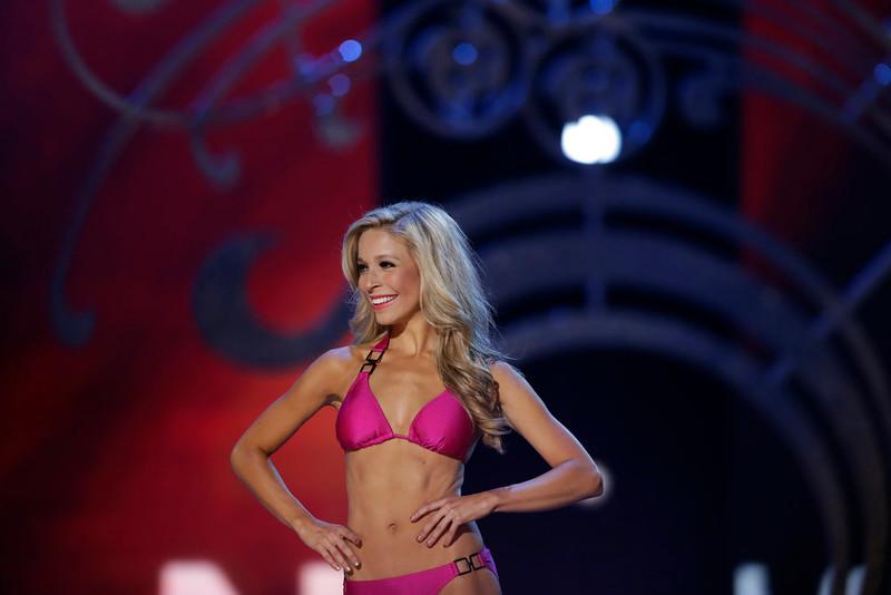 . Miss New York Kira Kazantsev displays her swimsuit during the Miss America 2015 pageant, Sunday, Sept. 14, 2014, in Atlantic City, N.J. (AP Photo/Julio Cortez)