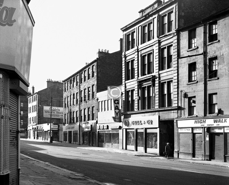 Gallowgate, south side, from Little Dovehill.   All these buildings are still there, but in badly mutilated form, reduced to one or two storeys. This is the cheapest and shabbiest course of action, and one much employed around here.   I don't think 'Gay Fashions' meant what it would mean today.    May 1974