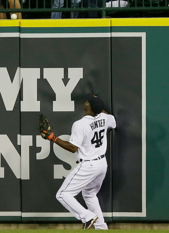. Detroit Tigers right fielder Torii Hunter watches as the home run by Chicago White Sox designated hitter Adam Dunn hits the top of the wall during the ninth inning of a baseball game, Wednesday, July 30, 2014 in Detroit. (AP Photo/Carlos Osorio)