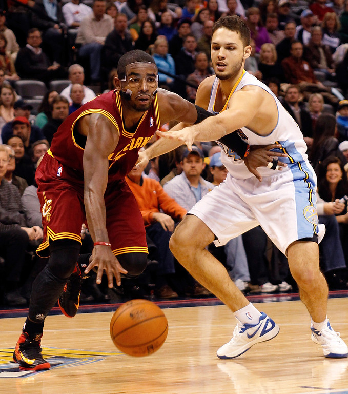 . Kyrie Irving #2 of the Cleveland Cavaliers drives in the first half against Evan Fournier #94 of the Denver Nuggets at Pepsi Center on January 11, 2013 in Denver, Colorado. (Photo by Chris Chambers/Getty Images)