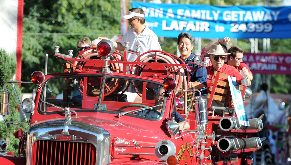 . A vintage fire truck during the Diamond Bar community parade during the 91st Annual L.A. County Fair in Pomona, Calif. on Thursday, Sept. 5, 2013.   (Photo by Keith Birmingham/Pasadena Star-News)
