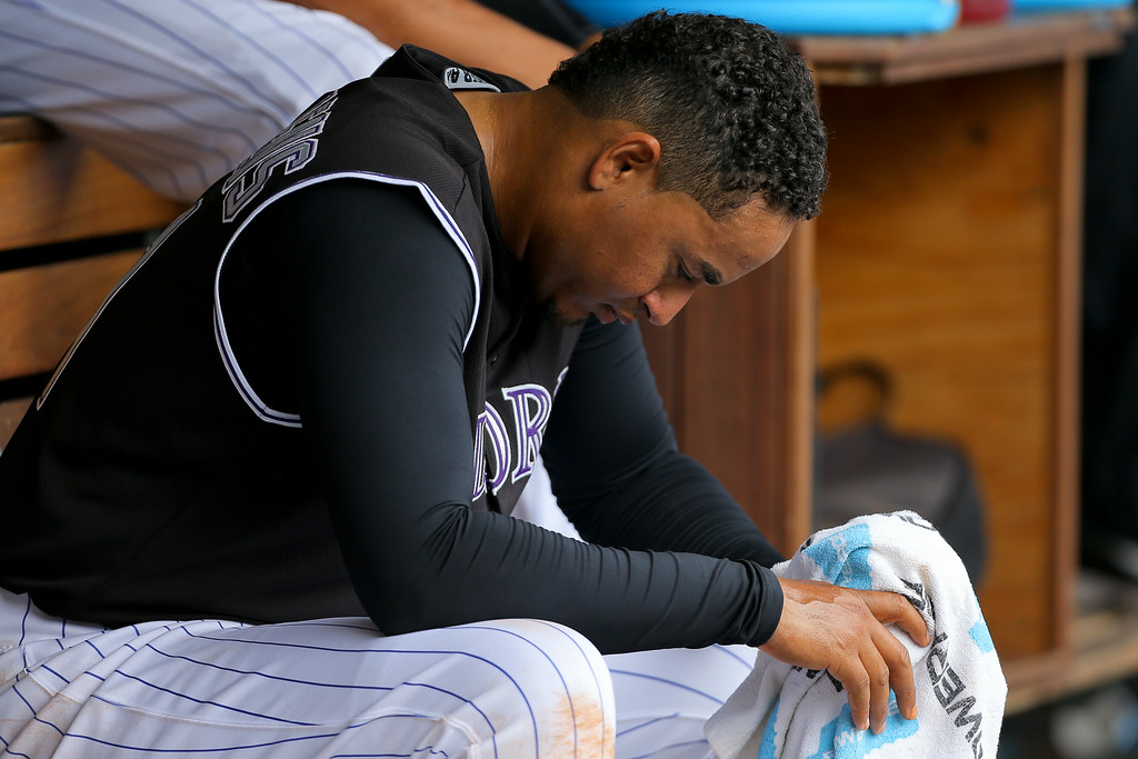 . DENVER, CO - JULY 9:  Starting pitcher Jair Jurrjens #41 of the Colorado Rockies sits in the dugout after being pulled from the game in the fifth inning against the San Diego Padres at Coors Field on July 9, 2014 in Denver, Colorado. (Photo by Justin Edmonds/Getty Images)
