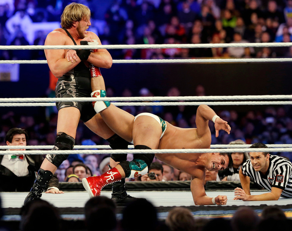 """. Jacob \""""Jake\"""" Hager, Jr., known as Jack Swagger, left, locks up the leg of Jose Alberto Rodr�guez, of Mexico, known as Alberto Del Rio, during the WWE Wrestlemania 29 wrestling event, Sunday, April 7, 2013, in East Rutherford, N.J. (AP Photo/Mel Evans)"""