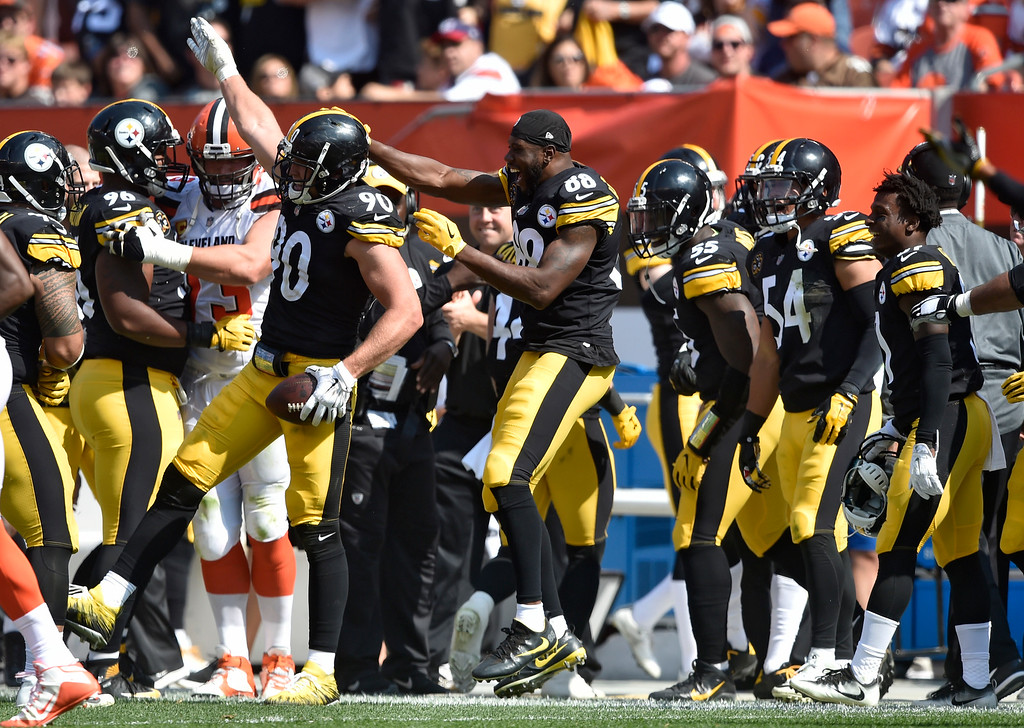 . Pittsburgh Steelers linebacker T.J. Watt (90) celebrates with teammates after making an interception during the second half of an NFL football game against the Cleveland Browns, Sunday, Sept. 10, 2017, in Cleveland. (AP Photo/David Richard)