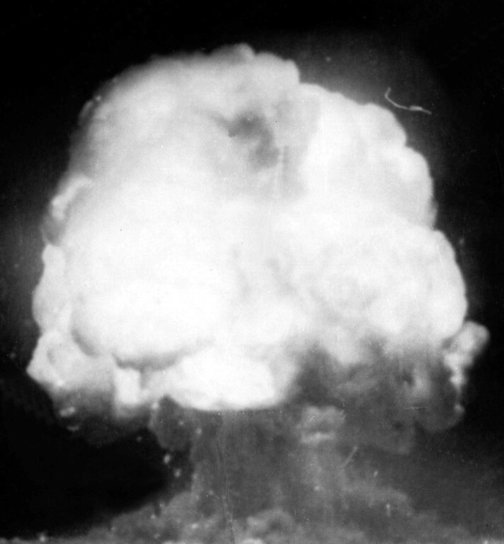 . The first U.S. atom bomb explodes during a test in Alamogordo, N.M., July 16, 1945.  The cloud went 40,000 feet in the air, as viewed by an automatic camera six miles away from the site.  (AP Photo)