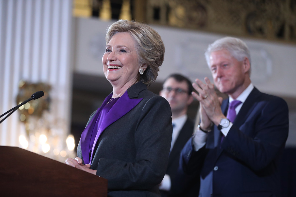 . Former President Bill Clinton applauds as his wife, Democratic presidential candidate Hillary Clinton speaks in New York, Wednesday, Nov. 9, 2016. Clinton conceded the presidency to Donald Trump in a phone call early Wednesday morning, a stunning end to a campaign that appeared poised right up until Election Day to make her the first woman elected U.S. president. (AP Photo/Andrew Harnik)