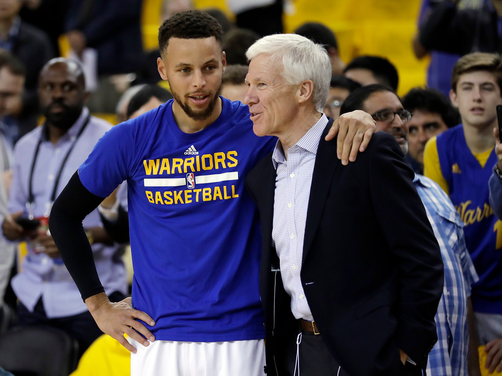 . Golden State Warriors\' Stephen Curry, left, hugs his former college coach Bob McKillop before Game 1 of basketball\'s NBA Finals against the Cleveland Cavaliers Thursday, June 1, 2017, in Oakland, Calif. (AP Photo/Marcio Jose Sanchez)