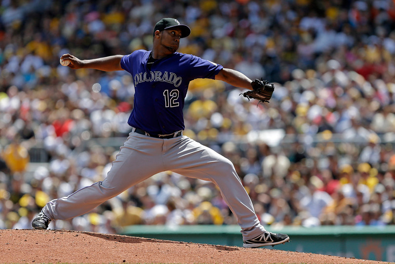 . Colorado Rockies starting pitcher Juan Nicasio (12) delivers in the third inning of a baseball game against the Pittsburgh Pirates in Pittsburgh Sunday, Aug. 4, 2013. (AP Photo/Gene J. Puskar)
