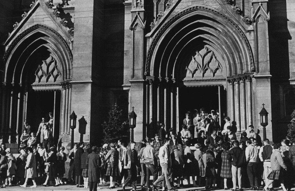 . Hundreds gather at Denver\'s Immaculate Conception Cathedral, where prayer services were held shortly after news of the assassination. Denver Post file
