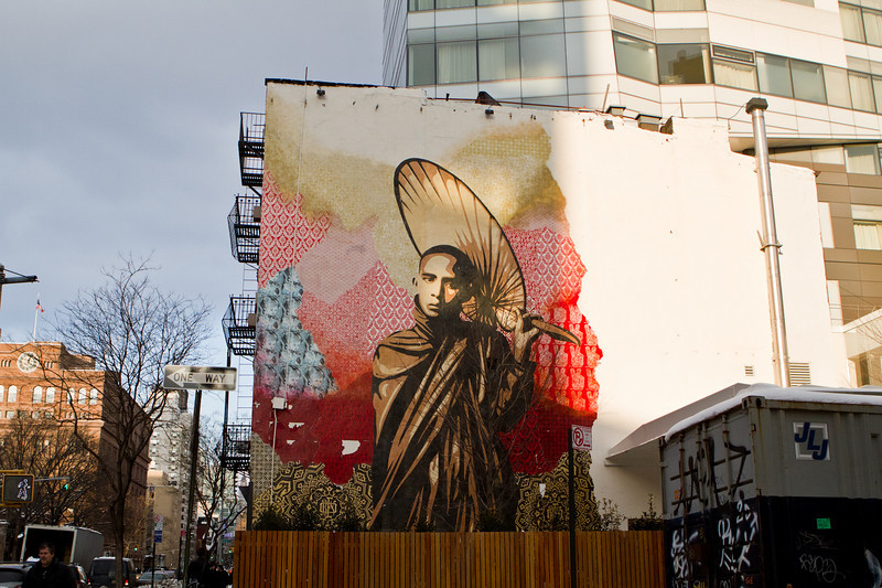 Insatallation Mural by artist Shepard Fairey. Fairey and members of Team OBEY edged fragments of the centerpiece, a pondering Burmese Buddhist Monk with umbrella