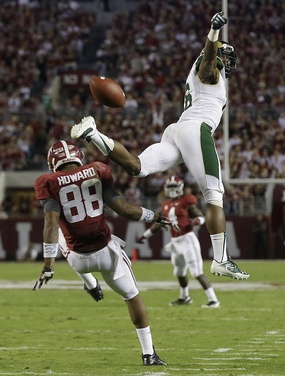 . Colorado State defensive back Kevin Pierre-Louis, right,breaks up a pass intended for Alabama tight end O.J. Howard (88) during the first half of an NCAA college football game in Tuscaloosa, Ala., Saturday, Sept. 21, 2013. (AP Photo/Dave Martin)