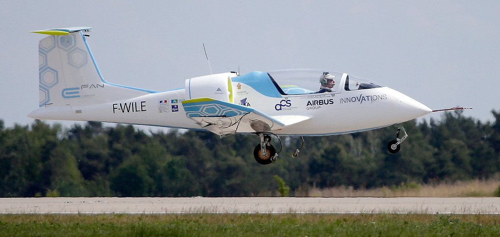 . An Airbus Group E-Fan electric aircraft lands during the ILA Berlin Air Show in Berlin, Germany, Tuesday, May 20, 2014. The Berlin Air Show takes place from May 20 until May 25, 2014 . (AP Photo/Michael Sohn)
