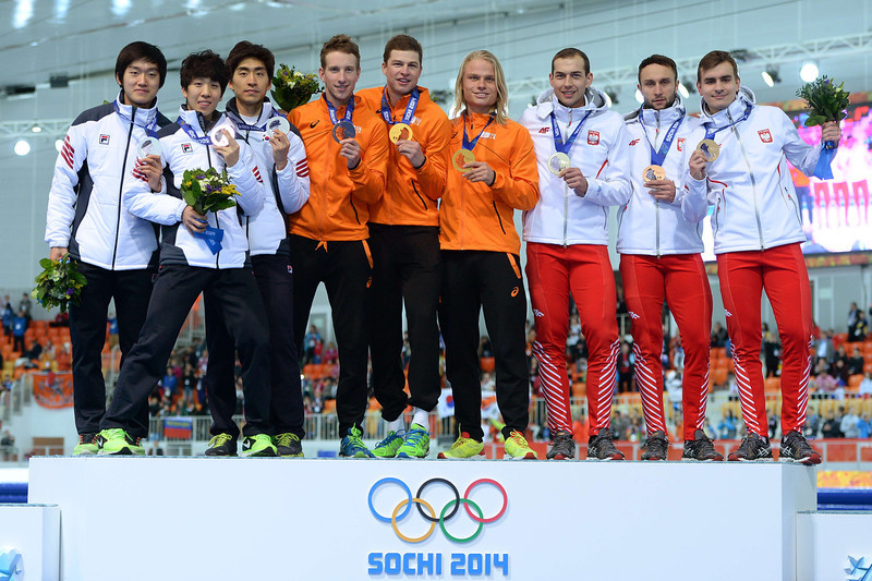 . South Korea\'s silver medalists (L) Joo Hyong-Jun, Kim Cheol-Min and Lee Seung-Hoon, Netherlands\' gold medalists (C) Jan Blokhuijsen, Sven Kramer and Koen Verweij and Poland\'s bronze medalist (R) Zbigniew Brodka, Konrad Niedzwiedzki and Jan Szymanski pose during the Men\'s Speed Skating Team Pursuit Medal Ceremony at the Adler Arena during the Sochi Winter Olympics on February 22, 2014. (JUNG YEON-JE/AFP/Getty Images)