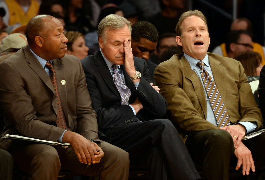 . Los Angeles Lakers head coach Mike D\'Antoni, center, with coach Kurt Rambis, right, and coach Johnny Davis in the second half during an NBA basketball game against the Dallas Mavericks in Los Angeles, Calif., on Friday, April 4, 2014. Dallas Mavericks won 107-95.  (Keith Birmingham Pasadena Star-News)