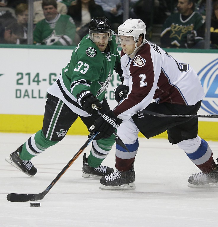 . Colorado Avalanche defenseman Nick Holden (2) takes control of the puck against Dallas Stars defenseman Alex Goligoski (33) during the first period of an NHL hockey game Tuesday, Feb. 3, 2015, in Dallas. (AP Photo/LM Otero)