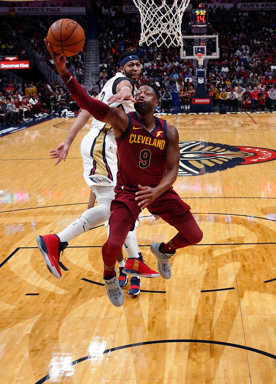 . Cleveland Cavaliers guard Dwyane Wade (9) drives to the basket against New Orleans Pelicans forward Anthony Davis, behind, in the second half of an NBA basketball game in New Orleans, Saturday, Oct. 28, 2017. The Pelicans won 123-101. (AP Photo/Gerald Herbert)