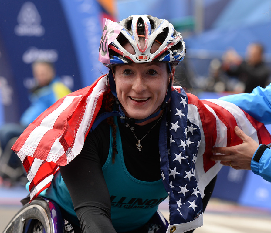 . Tatyana McFadden of the US has the flag draped over her shoulders after winning the women\'s wheelchair division in the 2014 TCS New York City Marathon November 2, 2014 in New York.  AFP PHOTO/Don EmmertDON EMMERT/AFP/Getty Images