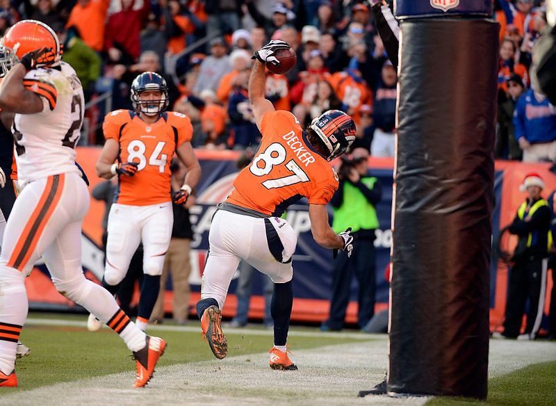 . Denver Broncos wide receiver Eric Decker (87) celebrates after scoring in the first half.  The Denver Broncos vs Cleveland Browns at Sports Authority Field Sunday December 23, 2012. John Leyba, The Denver Post