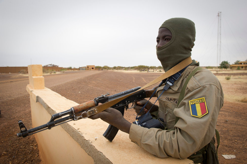 Description of . This picture provided by the French Army Communications Audiovisual office (ECPAD) and released Monday Jan. 28, 2013 shows a Chadian soldier securing Gao airport, north of Mali, Saturday, Jan. 26, 2013.  French and Malian forces pushed toward the fabled desert town of Timbuktu on Sunday, as the two-week-long French mission gathered momentum against the Islamist extremists who have ruled the north for more than nine months. (AP Photo/Ghislain Mariette, EMA-ECPAD)