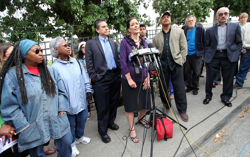 . Council member Libby Schaaf speaks to her constituents in the Maxwell Park neighborhood about the rise in crime at a press conference at the site where Judy Salamon was shot and killed driving on Fern Street in Oakland, Calif., on Friday, July 26, 2013.  (Laura A. Oda/Bay Area News Group)