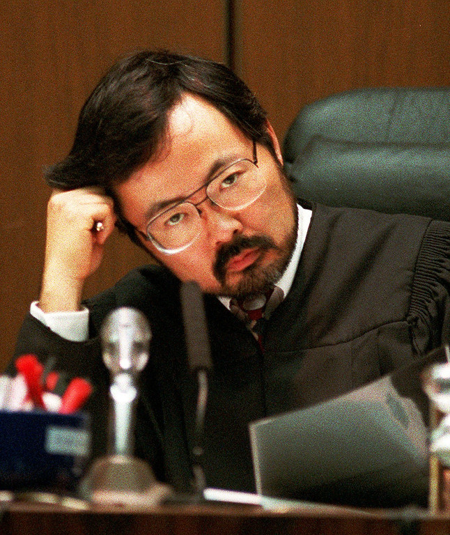 . Judge Lance Ito speaks to lawyers Friday morning, Sept. 8, 1995, as the prosecution in the O.J. Simpson double-murder trial objected to various defense exhibits. In a partial victory for Simpson prosecutors, an appeals court today ordered Ito to withdraw a jury instruction about Mark Fuhrman or explain his decision further to the higher court. (AP Photo/Eric Draper, Pool)