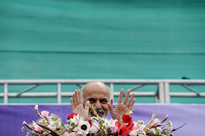 . Afghan presidential candidate Ashraf Ghani Ahmadzai gestures during an election rally at the Ghazi Stadium in Kabul on April 1, 2014. Afghanistan will vote on April 5 to choose a successor to President Hamid Karzai and to decide the make-up of 34 provincial councils in elections seen as a benchmark of progress since the Taliban were ousted from power in 2001. Eight candidates are running in the April 5 presidential election, with a second round run-off between the two leading contenders expected in late May. (WAKIL KOHSAR/AFP/Getty Images)