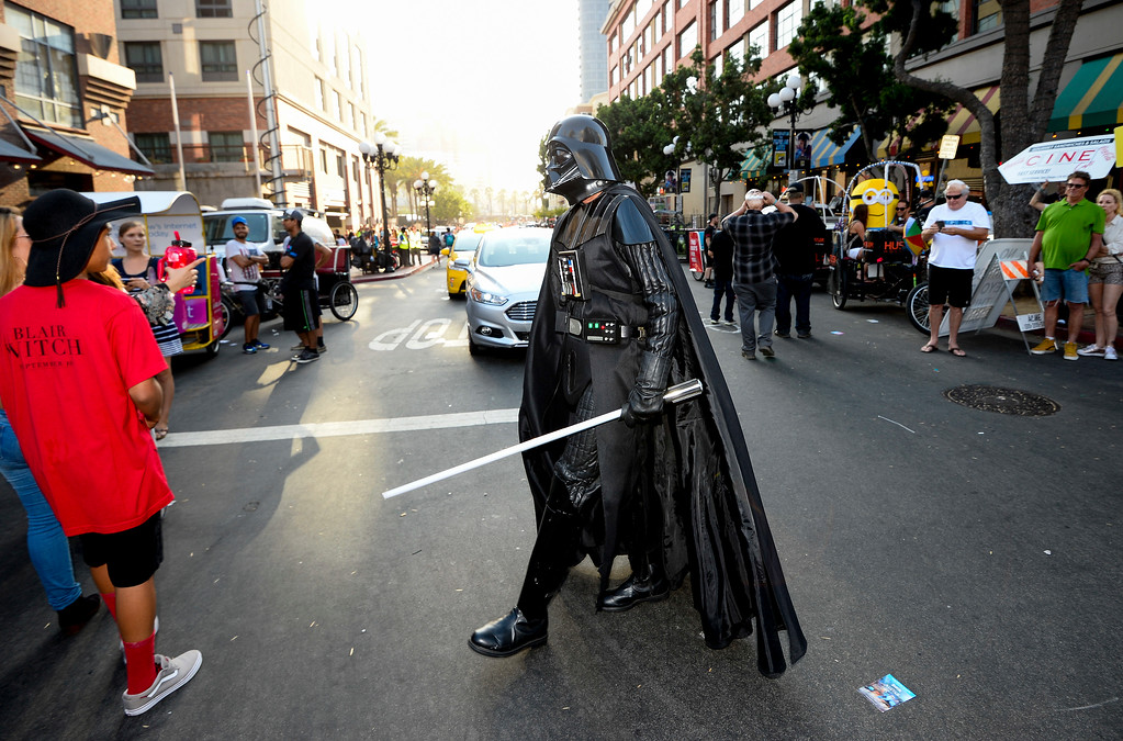 . A fan dressed as Star War\'s Darth Vader walks down the street on day three of the Comic-Con International held at the San Diego Convention Center Saturday, July 23, 2016 in San Diego.  (Photo by Denis Poroy/Invision/AP)