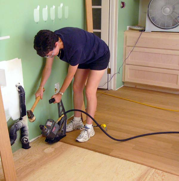 July 3 - Shelly is installing some of the flooring, using a pneumatic floor nailer.  This tool can be mastered in just a few minutes.