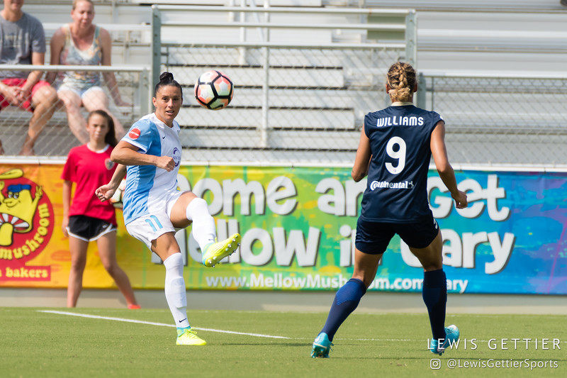 Ali Krieger (11) and Lynn Williams (9) during a match between the NC Courage and the Orlando Pride in Cary, NC in Week 3 of the 2017 NWSL season. Photo by Lewis Gettier.