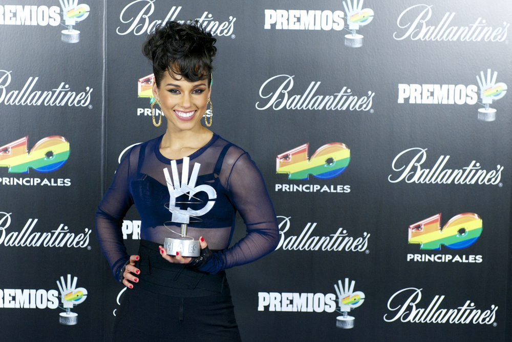 Description of . Alicia Keys poses in the press room during 40 Principales Awards 2012 at the Palacio de Deportes on January 24, 2013 in Madrid, Spain.  (Photo by Juan Naharro Gimenez/Getty Images)