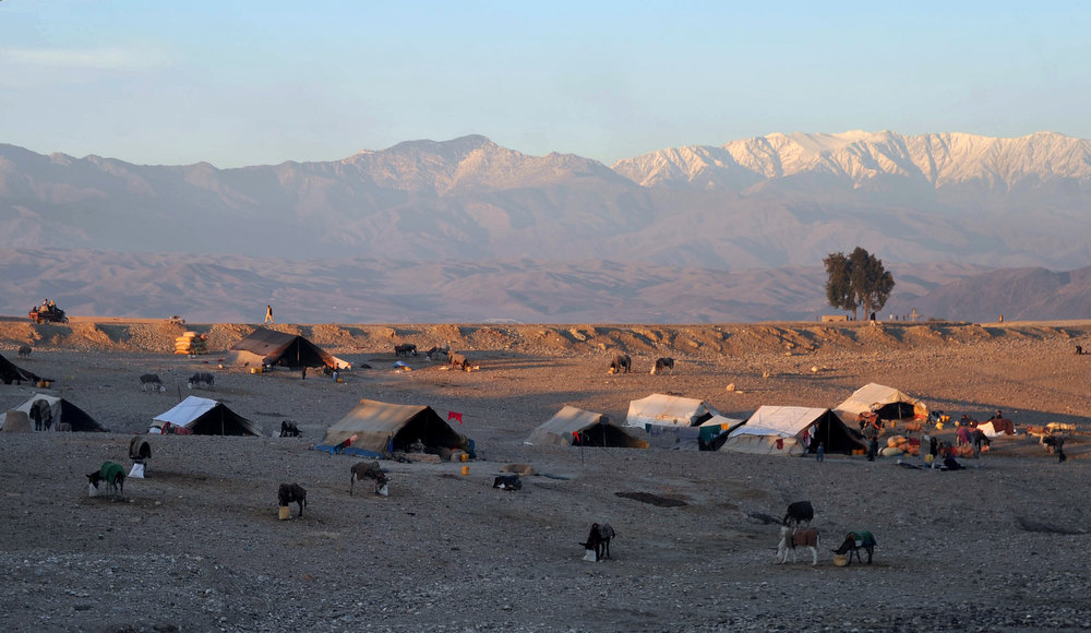 Description of . Tents belonging to internally displaced Afghan refugees are pictured on the outskirts of Jalalabad on December 21, 2012. Over a third of Afghans are living in abject poverty, as those in power are more concerned about addressing their vested interests rather than the basic needs of the population, a UN report said. Noorullah Shirzada/AFP/Getty Images