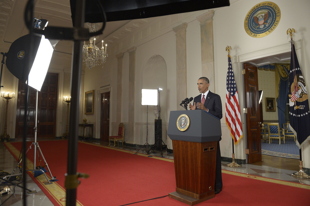 """. US President Barack Obama delivers a prime time address from the Cross Hall of the White House on September 10, 2014 in Washington, DC.  Vowing to target the Islamic State with air strikes \""""wherever they exist\"""", Obama pledged to lead a broad coalition to fight IS and work with \""""partner forces\"""" on the ground in Syria and Iraq.  AFP PHOTO/POOL/Saul LOEBSAUL LOEB/AFP/Getty Images"""