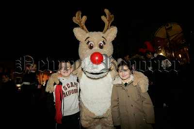 Eoin Doyle and Caragh Coyle pictured with Rudolph at the switching of the Christmas lights in Newry on Thursday last. 06W48N15