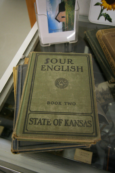 English book with typical school child graffiti at Lincoln Museum, Lincoln, Kansas.