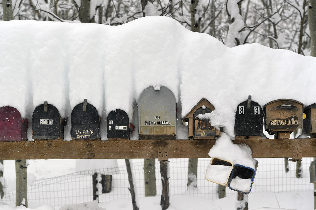 . NEDERLAND, CO - APRIL 17: Mailboxes are laden with snow on April 17, 2016 in Nederland, Colorado. A slow moving spring storm dumped almost 3 feet of snow in the foothills.  (Photo by Helen H. Richardson/The Denver Post)