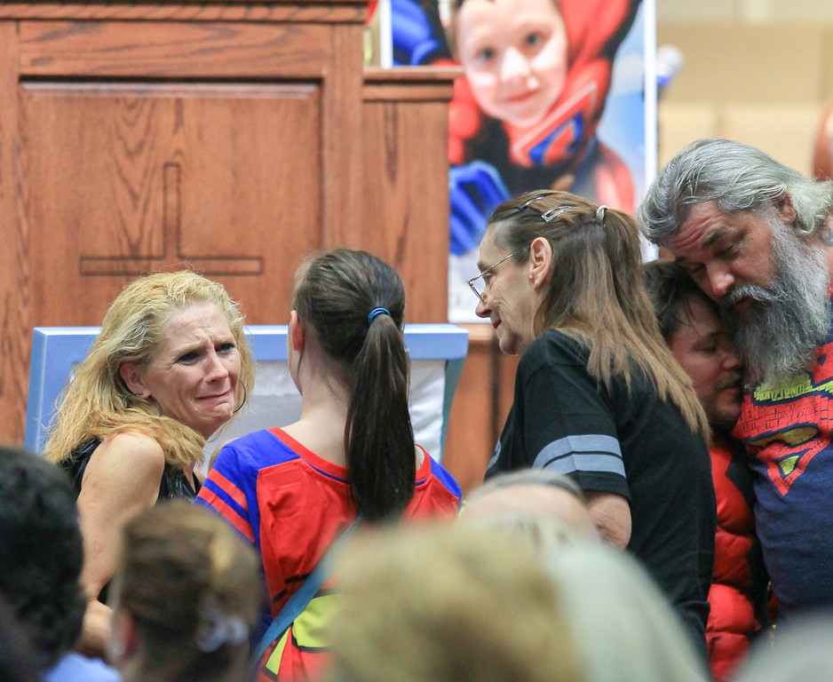 . Renae Hall, left, mother of Jacob Hall, talks to Starr Henderson, 12, of Belton, S.C., during a wake service for Jacob Hall, at Oakdale Baptist Church, Tuesday, Oct. 4, 2016 in Townville, S.C. Townspeople and classmates filled a church Tuesday evening to say goodbye to Jacob Hall, a 6-year-old boy who died in a school shooting, filing past a casket adorned with large photos, balloons and a life-size figure of one of his favorite superheroes, Batman.(Ken Ruinard/The Independent-Mail via AP, Pool)