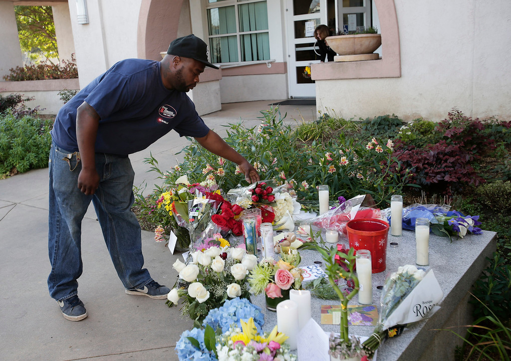 ". William Elmore drops flowers at makeshift memorial for slain Santa Cruz police officers, detective <a href=""http://www.santacruzsentinel.com/localnews/ci_22676928/loran-butch-baker-28-year-veteran-leaves-legacy\"">Sgt. Loran \""Butch\"" Baker</a> and detective <a href=\""http://www.santacruzsentinel.com/localnews/ci_22676931/santa-cruz-police-detective-elizabeth-butler-policing-was\"">Elizabeth Butler</a> in front of the police department in Santa Cruz, Calif. on Wednesday, Feb. 27, 2013. The pair were <a href=\""http://www.santacruzsentinel.com/localnews/ci_22674808/breaking-2-officers-1-suspect-shot-santa-cruz\"">gunned down yesterday</a> while investigating a possible domestic violence or sexual assault when a suspect fired at them. The gunman, Jeremy Peter Goulet, was later gunned down when he exchanged gunfire with police during a manhunt.  (Gary Reyes/ Staff)"