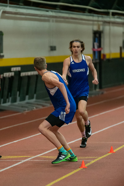 Jarret Muzzy (junior) hands the baton to Gabe Praamsma (junior) in the 4x800 relay. VUHS takes home first place while setting an event record with a time of 8:42.92 in the Boys 4x800 relay. Vermont Division II Indoor Track State Championships - UVM Gutterson Field House Junior Jarret Muzzy in the second leg of the 4x800 relay. VUHS takes home first place while setting an event record with a time of 8:42.92 in the Boys 4x800 relay. Vermont Division II Indoor Track State Championships - UVM Gutterson Field House - 2/16/2020