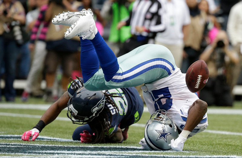 . Dallas Cowboys running back DeMarco Murray tumbles in the end zone after he scored a touchdown after a too-late tackle by Seattle Seahawks cornerback Richard Sherman, left, in the second half of an NFL football game against the Seattle Seahawks, Sunday, Oct. 12, 2014, in Seattle. (AP Photo/Elaine Thompson)